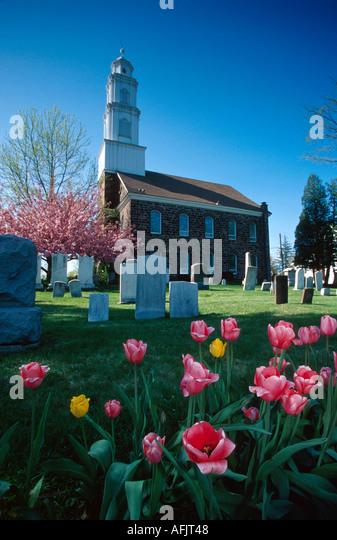 New Jersey Fairfield Dutch Reformed Church tulips gravestones springtime - Stock Image