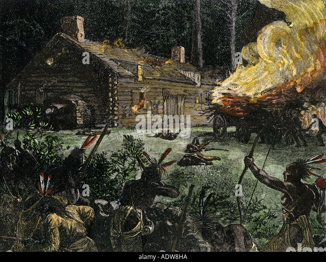 Native Americans night attack setting a pioneer log cabin on fire - Stock Image
