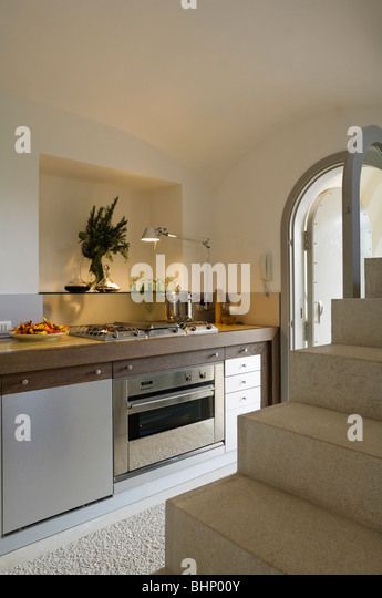 Kitchen with stairs in Italian farmhouse conversion - Stock Image