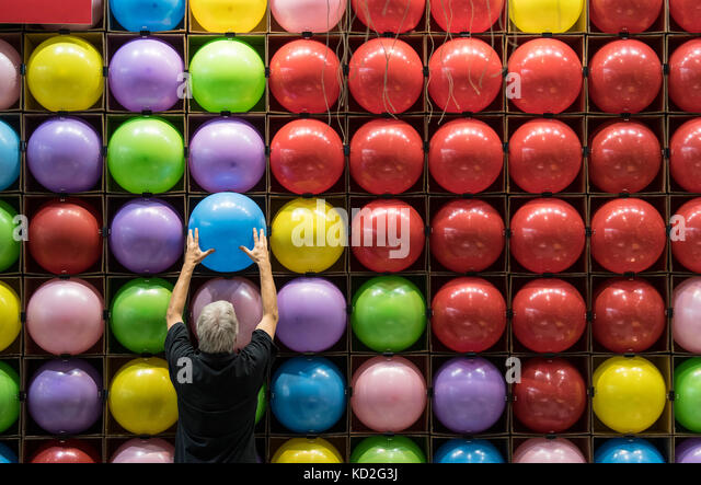 Frankfurt am Main, Germany. 9th Oct, 2017. Brightly coloured balloons are used to decorate the stall of a publishing - Stock Image
