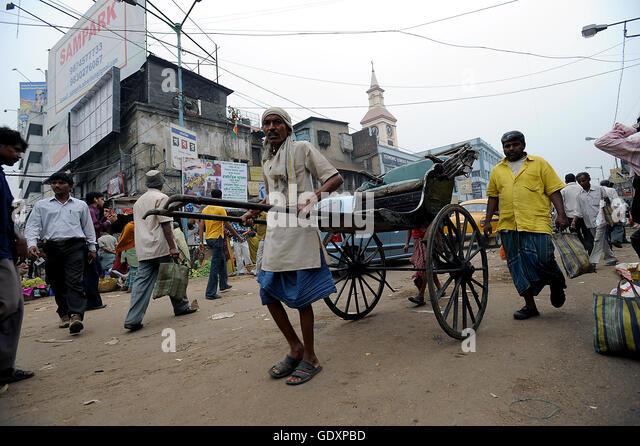 Rickshaw puller in Kolkata - Stock Image