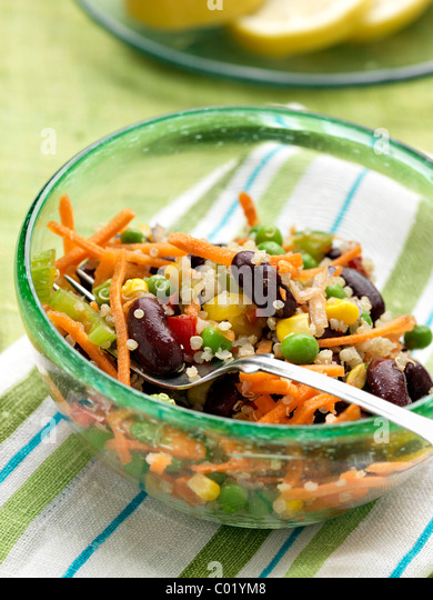 Vegetarian quinoa salad with peas carrots celery red kidney beans - Stock Image