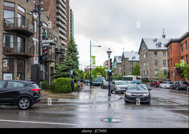 Montreal, Canada - May 26, 2017: Saint Laurent boulevard and Sherbrooke signs in Plateau area of city in Quebec - Stock Image