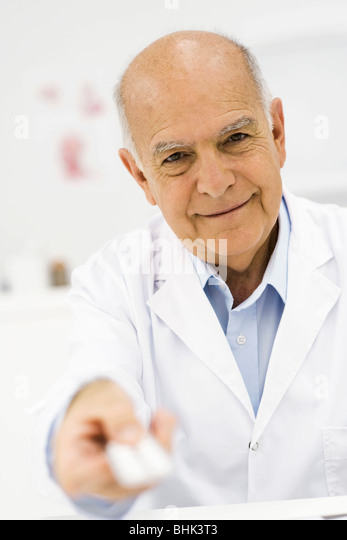 Doctor handing prescription medicine to patient, personal perspective - Stock Image
