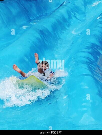 Boy On Water Slide - Stock Image