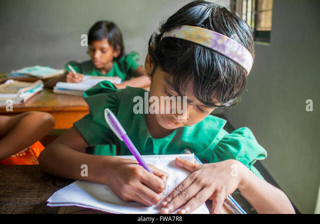 A little Girl writing NGO supported rural primary school classroom in SSS Center, Tangail, Dhaka © Jahangir - Stock-Bilder