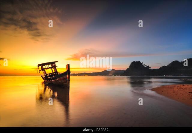 Cambodia, View of tongkang on sea at sunrise - Stock Image