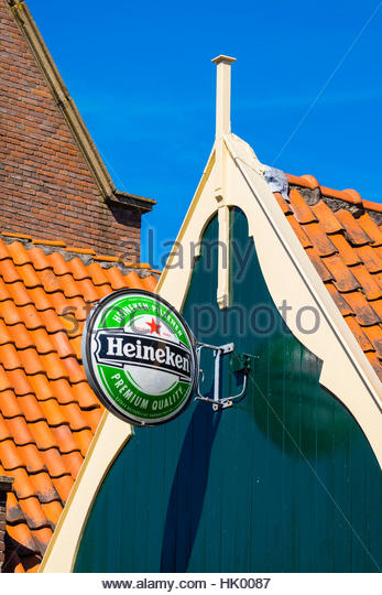 Heineken beer sign on the outside of a building. Edam, North Holland, Netherlands. - Stock Image