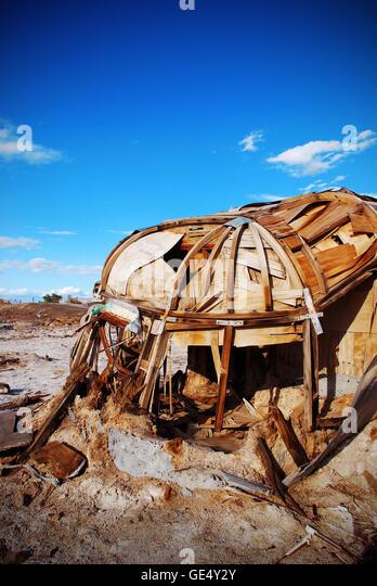 Ruined trailer at Bombay Beach, Salton Sea, California - Stock Image