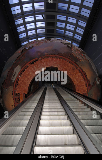 Escalator passing thru Planet Earth in the Natural History Museum London - Stock Image
