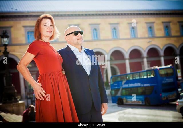 Senior couple stands on city street, Munich, Bavaria, Germany - Stock-Bilder