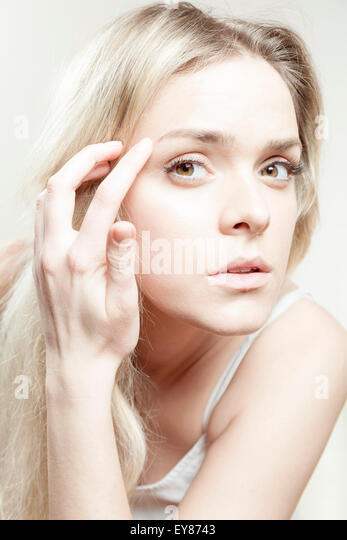 Young woman with blond hair - Stock Image