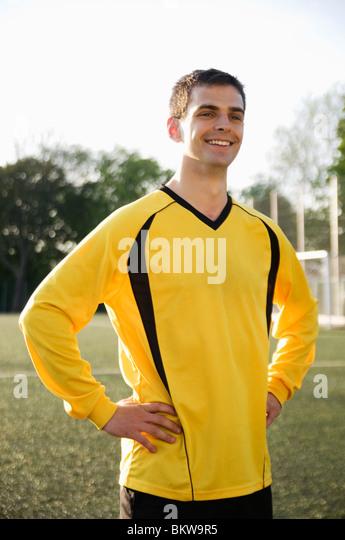Happy guy in yellow - Stock-Bilder