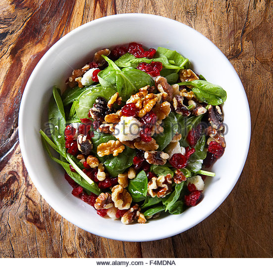 Spinach salad with pomegranet walnuts goat cheese - Stock Image