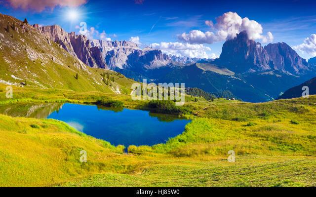 Sassolungo mountain range at sunny summer day. Dolomites mountains, Italy, Europe. - Stock Image