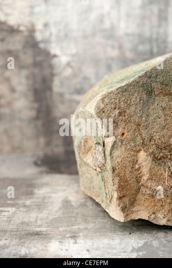 A natural big stone in an abstract gray background. - Stock-Bilder