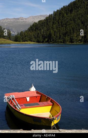 Switzerland Alpine Lake near St Moritz colorful fishing boat - Stock Image