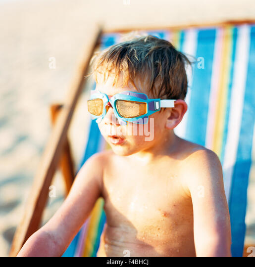bathing beach boys children only color image dive holiday journey one person only sandy beach summer sun chair - Stock-Bilder