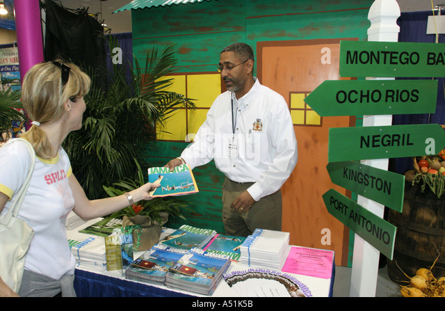 Florida Coconut Grove Convention Center Miami Herald Travel Expo Jamaica tour promoter female consumer brochure - Stock Image