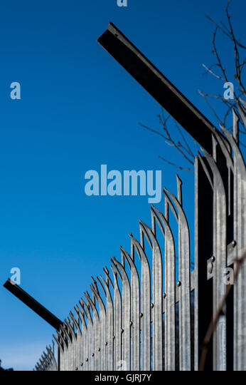 Security fencing against a blue sky, Avonmouth, Bristol - Stock Image