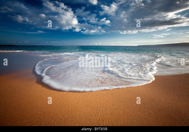 Beach, wave and clouds. Maui, Hawaii. - Stock Image