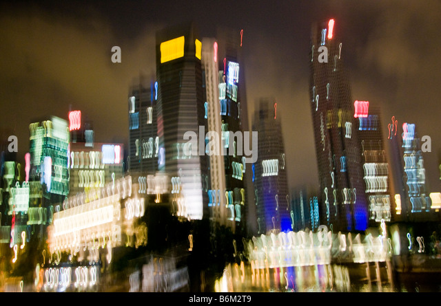 City view of downtown Singapore skyline at night - Stock Image