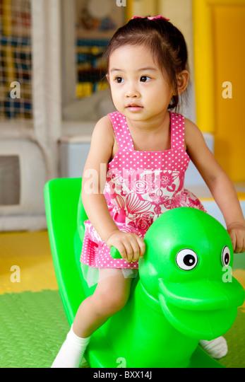 Girl Playing - Stock Image