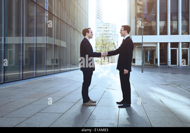 two businessmen shaking hands - Stock-Bilder
