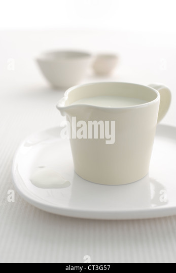 Close up of pitcher of milk - Stock Image