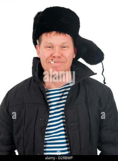 Russian man in winter fur cap ,red-neck.isolated on white background - Stock Image