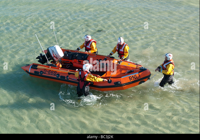 The RNLI launch their inflatable rescue boat at St Ives - Stock Image