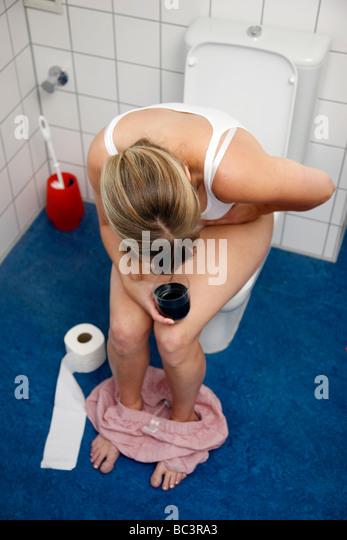 Girl toilet diarrhea stock photos girl toilet diarrhea - How to use the bathroom when constipated ...