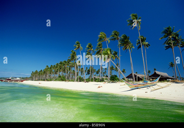 Beach on the west coast of resort island of Boracay off the coast of Panay, in the Philippines, Southeast Asia - Stock Image