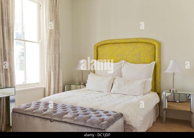 Bed in luxury bedroom - Stock Image