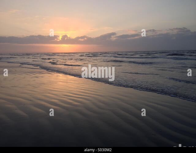 Sunrise on Galveston Island - Stock Image