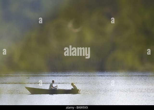 Two people in a small boat - Stock Image