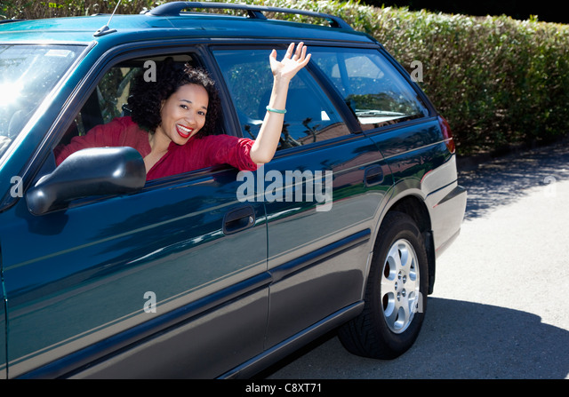 USA, California, Fairfax, woman driving car and waving - Stock Image