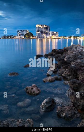 Mandurah, Western Australia. Foreshore apartment buildings reflected in Mandurah Estuary. - Stock Image