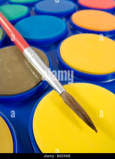 New watercolor box with brush - Stock-Bilder