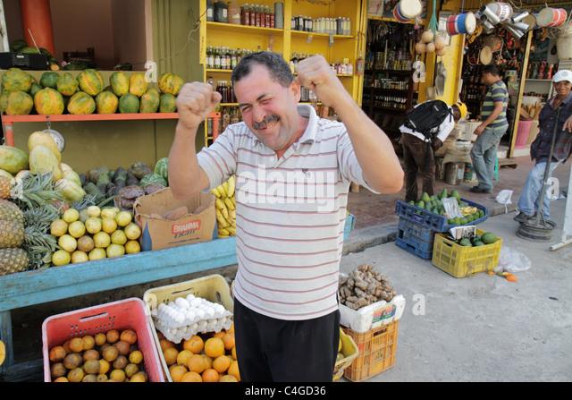 Santo Domingo Dominican Republic Ciudad Colonia Mercado Modelo market marketplace Hispanic man vendor fresh produce - Stock Image