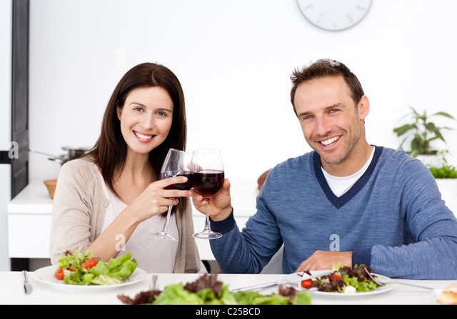 Portrait of a happy couple drinking red wine at lunch - Stock-Bilder