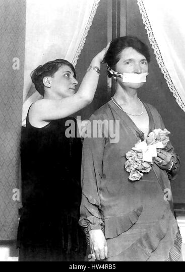MARGARET SANGER (1879-1966) American advocate of birth control. Here she is having her mouth taped shut  as a publicity - Stock-Bilder
