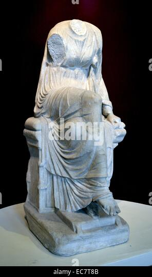 Marble statue of a seated muse. This is Clio, the muse of history who holds a scroll in her left hand.  Roman, AD - Stock Image