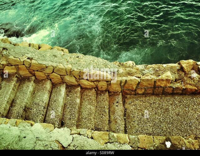Old steps by the sea - Stock Image