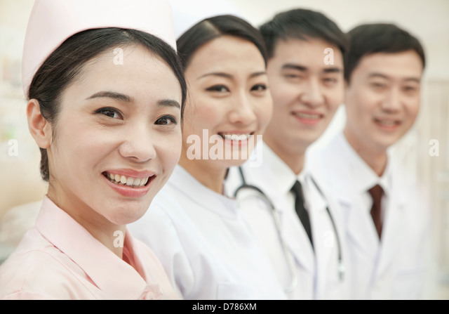 Healthcare workers standing in a row, China - Stock Image