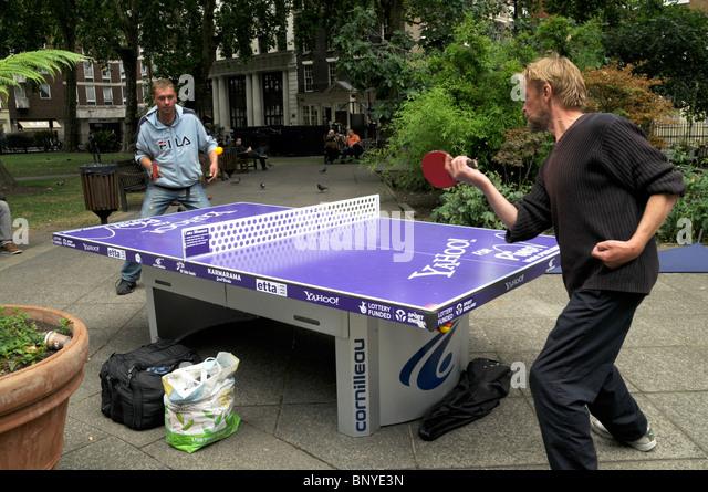 LONDON PUBLIC TABLE TENNIS AT SOHO SQUARE - Stock Image
