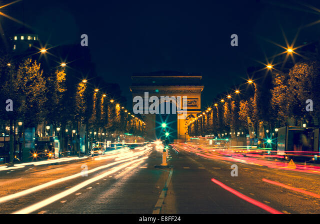 France, Paris, Avenue des Champs-Elyses at night - Stock Image