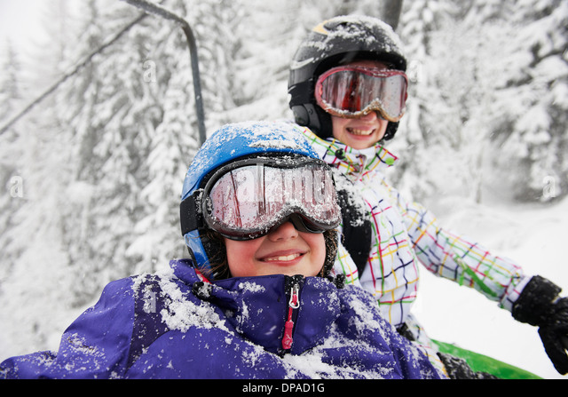 Portrait of snow covered sisters, Villaroger, Hauste Savoie, France - Stock Image