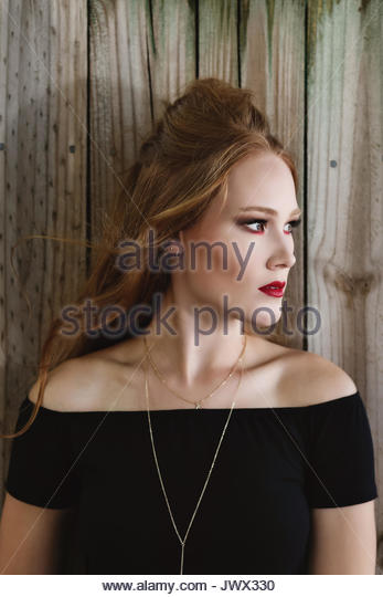 Portrait of a red haired woman looking away - Stock Image