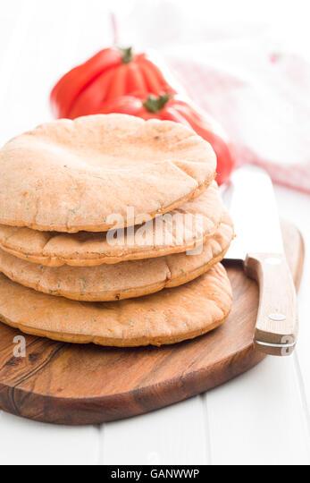 Tasty pita bread on white kitchen table. - Stock Image